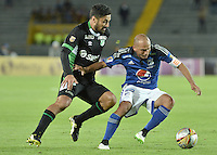BOGOTA - COLOMBIA -19 -08-2015: Mayer Candelo (Der) jugador de Millonarios disputa el balón con Andres Perez (Izq) jugador de Deportivo Cali durante partido por la fecha 7 de la Liga Águila II 2015 jugado en el estadio Nemesio Camacho El Campín de la ciudad de Bogotá./ Mayer Candelo (R) player of Millonarios fights for the ball with Andres Perez (L) player of Deportivo Cali during the match for the 7th date of the Aguila League II 2015 played at Nemesio Camacho El Campin stadium in Bogotá city. Photo: VizzorImage / Gabriel Aponte / Staff.