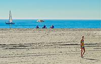Blonde Girl in Bikini Walking on the Sand of Newport Beach