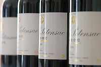 A row of bottles lined up on a table for tasting Chateau Potensac Cru Bourgeois Ordonnac Medoc Bordeaux Gironde Aquitaine France