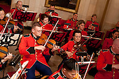 Washington, DC - November 24, 2009 -- A United States Marine Corps band plays before the arrival of U.S. President Barack Obama and Manmohan Singh, India's prime minister, in the Crosshall of the White House in Washington, D.C., U.S., on Tuesday, November 24, 2009. Obama welcomed India's role as a rising and responsible global power, saying the U.S. will follow through on a civilian nuclear agreement and work to expand trade and investment ties with the world's largest democracy. .Credit: Andrew Harrer - Pool via CNP