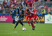 27 July 2010: Club Deportivo Motagua forward Georgie Wilson Welcome Collins and Toronto FC midfielder Joseph Nane #15 in action during a CONCACAF Preliminary game between Club Deportivo Motagua and Toronto FC at BMO Field in Toronto..Toronto FC won 1-0....