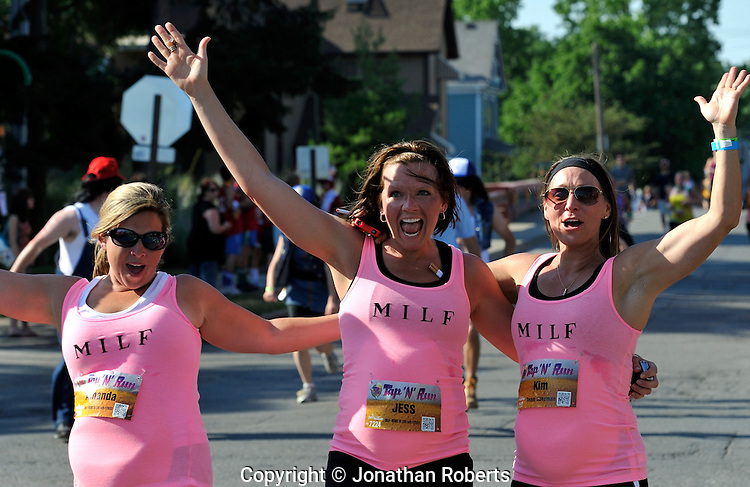 Tap 'n' Run Indianapolis 2012. .Tap 'n' Run combines a ridiculous running race - a 4k with 4 beer stops along the way, crazy costumes, great times with friends, and unbelievable athleticism, developed by JAM Active..Photo by Jonathan Roberts