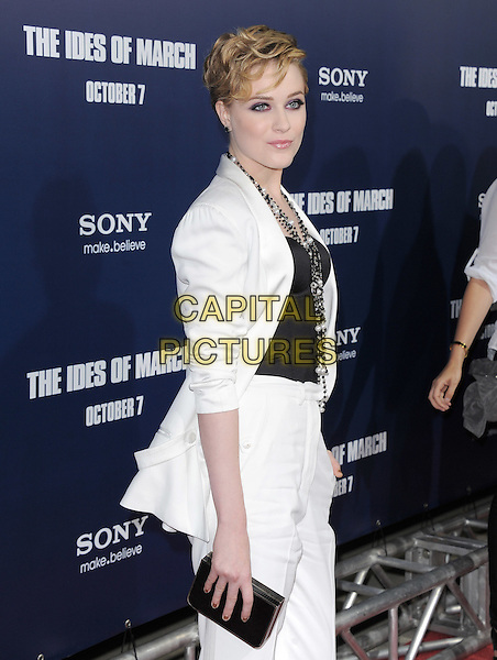 Evan Rachel Wood.The L.A. Premiere of 'The Ides of March' held at The Academy of Motion Picture Arts & Sciences  in Beverly Hills, California, USA..September 27th, 2011.half length suit blazer jacket side clutch bag black white pearl corset necklace .CAP/RKE/DVS.©DVS/RockinExposures/Capital Pictures.