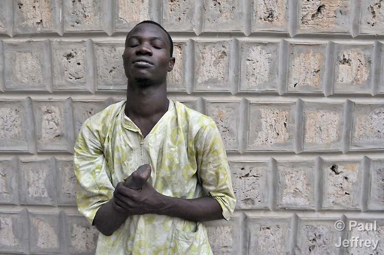 Maman Dedeou, 22, had his right hand amputated by Islamist radicals who seized his home town of Timbuktu in northern Mali in 2012. After he was accused of stealing a mattress, Dedeou's family paid fines to the jihadis for weeks, but when their ability to pay ran out, the Islamists cut off Dedeou's hand. He later fled to Bamako, the nation's capital, but returned to Timbuktu in April 2013, several weeks after it was liberated by French and Malian troops. He's currently looking for work.
