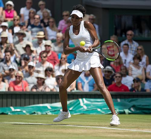 July 10th 2017, All England Lawn Tennis and Croquet Club, London, England; The Wimbledon Tennis Championships, Day 7; Venus Williams (USA) hits a backhand return to Ana Konjuh (CRO)