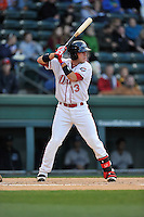 Catcher Austin Rei (13) of the Greenville Drive bats in a game against the Asheville Tourists on Thursday, April 7, 2016, at Fluor Field at the West End in Greenville, South Carolina. Greenville won, 4-3. (Tom Priddy/Four Seam Images)