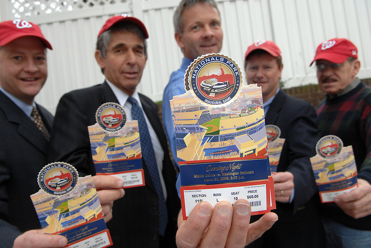 From left, Bill Simmons, Arthur Silverman, Mark Irion, David Beightol, and Ron Kaufman, all from Dutko Worldwide, show off the Nationals tickets for the inaugural game.