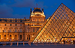 Louvre Museum and Pyramid at night in Paris, France