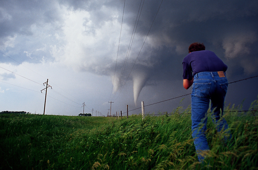 Weather photographer Gene Rhoden captures a developing tornado on film near Stuart Nebraska on June 9th, 2003.