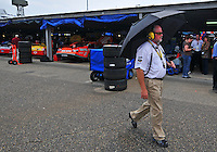 May 31, 2008; Dover, DE, USA; A Nascar Sprint Cup Series official walks through the garage during a rain delay in practice for the Best Buy 400 at the Dover International Speedway. Mandatory Credit: Mark J. Rebilas-US PRESSWIRE
