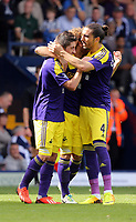 Pictured L-R: Pablo Hernandez of Swansea celebrating his goal with team mates Chico Flores and Jose Canas.<br />