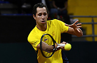 BOGOTA-COLOMBIA, 06-03-2020: Daniel Galan de Colombia devuelve la bola a Leandro Mayer de Argentina, durante partidos de los enfrentamientos para Las clasificatorias Copa Davis by Rakuten 2020 entre Colombia y Argentina en el Palacio de los Deportes en la ciudad de Bogota. / Daniel Galan of Colombia returns the ball to Leandro Mayer of Argentina during matches of the clashes for the Davis Cup by Rakuten 2020 qualifiers between Colombia and Argentina at the Palacio de los Deportes in Bogota city. / Photo: VizzorImage / Luis Ramirez / Staff.