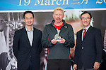 Tennis legend Boris Becker (center) receives and gives a gift to Joseph Wang (left) and Philip Mok (right) during the press conference for the opening of Boris Becker Tennis Academy at Mission Hills Resort on 19 March 2016, in Shenzhen, China. Photo by Lucas Schifres / Power Sport Images