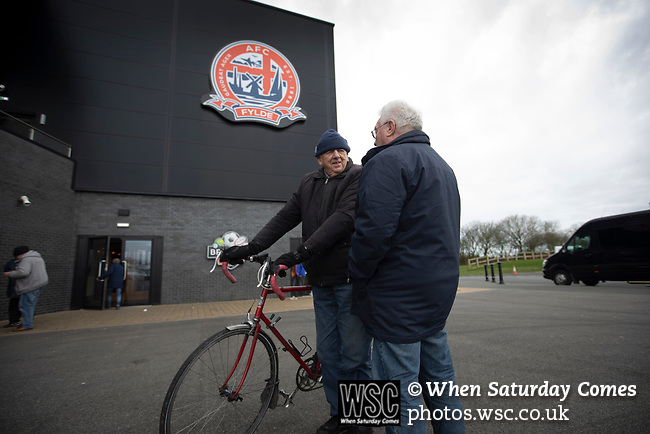 AFC Fylde 1, Aldershot Town 0, 14/03/2020. Mill Farm, National League. Two home supporters arriving at the stadium before AFC Fylde took on Aldershot Town in a National League game at Mill Farm, Wesham. The fixture was played against the backdrop of the total postponement of all Premier League and EFL football matches due to the the coronavirus outbreak. The home team won the match 1-0 with first-half goal by Danny Philliskirk watched by a crowd of 1668. Photo by Colin McPherson.