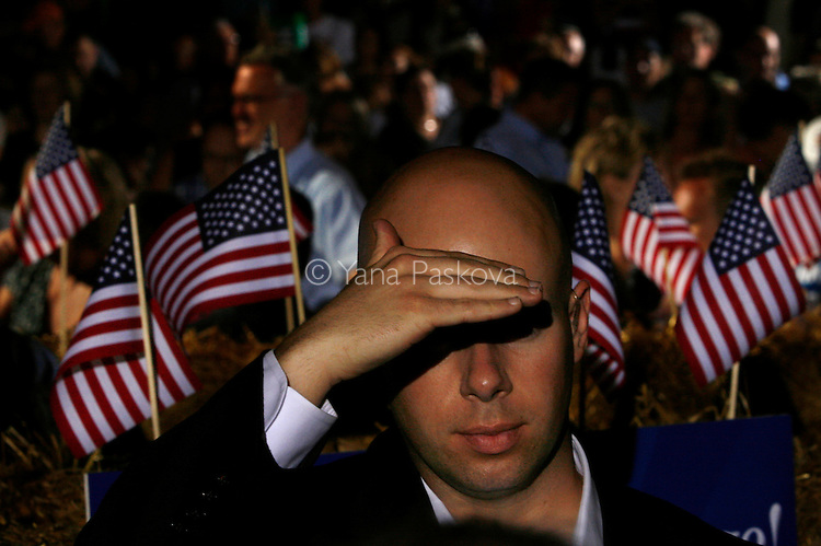 A Secret Service guard scans his surroundings as Democratic Presidential hopeful Hillary Clinton (D-NY) and her husband, former President Bill Clinton, mingle with the crowd at the Iowa State Fairgrounds in Des Moines, Iowa, on July 2, 2007.