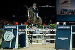Riders compete at the HKJC Trophy during the Longines Hong Kong Masters 2015 at the AsiaWorld Expo on 13 February 2015 in Hong Kong, China. Photo by Xaume OIleros / Power Sport Images