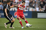 13 June 2009: Chicago's Marco Pappa (right) scores a goal past DC's Chris Pontius (left). DC United defeated the Chicago Fire 2-1 at RFK Stadium in Washington, DC in a regular season Major League Soccer game.