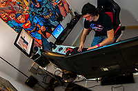 Juan Bustos, a Colombian webcam industry entrepreneur, remotely administrates the daily operations of his studio and provides support for dozens of semi-independent webcam models broacasting in Medellín, Colombia, 9 March 2016. With the traditional adoration of female beauty in Colombia, together with rapidly developing telecommunications technologies, the millennial generations of Colombian girls have turned the city of Medellín during the past few years into a one of the world centers of webcam modelling, a booming interractive sex industry. Thousands of young women stream everyday via websites that allow the global viewers to personally interract with a model and to pay them for sexually related acts. Although the core of the show is always based on stripping, the crucial part of a cam girl's success is communication. Cam models who have the ability of light conversation, flirting and entertaining the viewer earn thousands of dollars a month and have moved far beyond the borders of sexuality. Sharing their whole lives in a constant interaction with their online clients, they have built regular relationships in the cyberspace.