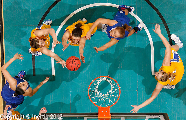 SIOUX FALLS, SD - MARCH 3:  Players from South Dakota State and IPFW try for rebounding position during their opening round game at the 2012 Summit League Basketball Championships Saturday at the Sioux Falls Arena. (Photo by Dick Carlson/Inertia)