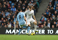 Barclays Premier League, Man City (blue) V Swansea City (white) Etihad Stadium, 27/10812<br /> Pictured: Swansea's Ben Davies takes on Nasri<br /> Picture by: Ben Wyeth / Athena Picture Agency
