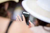 BALTIMORE, MD - MAY 20: Race fans take a selfie on an iPhone in the grandstand on Preakness Stakes Day at Pimlico Race Course on May 20, 2017 in Baltimore, Maryland.(Photo by Douglas DeFelice/Eclipse Sportswire/Getty Images)