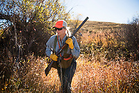 Molly Stratton, of Bozeman, Montana, hunts a creek bottom north of the Missouri River Breaks.
