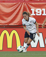 USWNT midfielder Heather O'Reilly (9) crosses the ball. In an international friendly, the U.S. Women's National Team (USWNT) (white/blue) defeated Korea Republic (South Korea) (red/blue), 4-1, at Gillette Stadium on June 15, 2013.