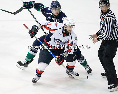 AJ Jenks (Plymouth - 22), Adam Henrique (Windsor - 14) - The Windsor Spitfires defeated the Plymouth Whalers 3-2 (OT) to sweep the Ontario Hockey League Western Conference Semi-Finals on Wednesday, April 7, 2010, at Compuware Arena in Plymouth, Michigan.
