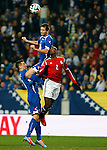 Bosnia-Herzegovina's Senad Lulic (Top) fights for the ball with Egypt's Aly Ghazal (R) during a FIFA World Cup 2014 friendly football match between Bosnia-Herzegovina and Egypt at the Tivoli Stadium, in Innsbruck on March 5, 2014. PHOTO / PIERRE TEYSSOT