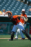 Bowie Baysox catcher David Freitas (46) throws a bunt attempt to first as pitcher Mikey O'Brien (26) looks on during a game against the Reading Fightin Phils on July 22, 2015 at Prince George's Stadium in Bowie, Maryland.  Bowie defeated Reading 6-4.  (Mike Janes/Four Seam Images)