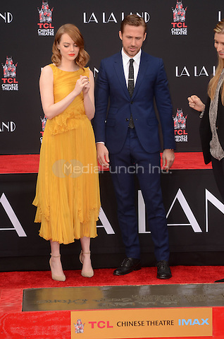 HOLLYWOOD, CA - DECEMBER 7: Emma Stone and Ryan Gosling at the Emma Stone and Ryan Gosling Hand and Foot Print Ceremony at the TCL Chinese Theater in Hollywood, California on December 7, 2016. Credit: David Edwards/MediaPunch