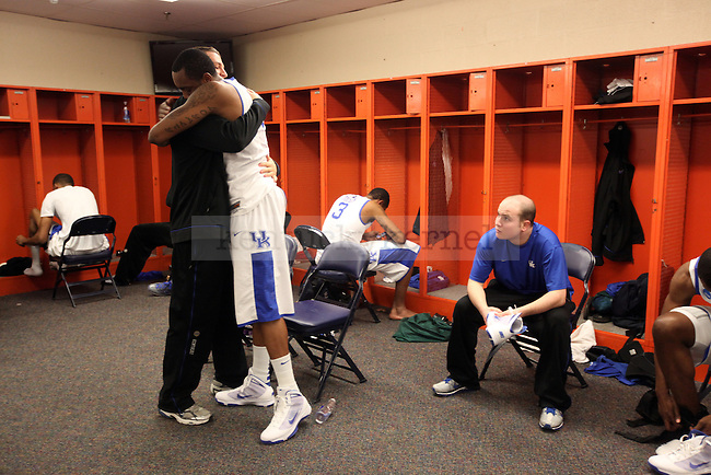Mark Krebs hugs Ramon Harris  in the locker room after their Elite 8 loss , 73-66, against West Virginia at the Carrier Dome in Syracuse, NY on  Saturday, March 27, 2010. Photo by Britney McIntosh | Staff
