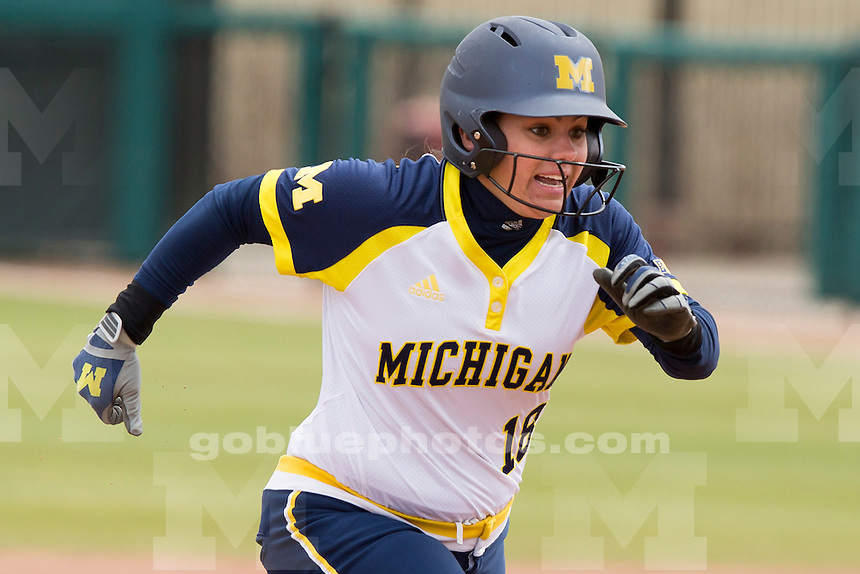 Michigan's Lindsay Montemarano (18) rounds second base during an NCAA college softball game on Saturday, April 2, 2016, in Bloomington, Indiana. (Photo by James Brosher)