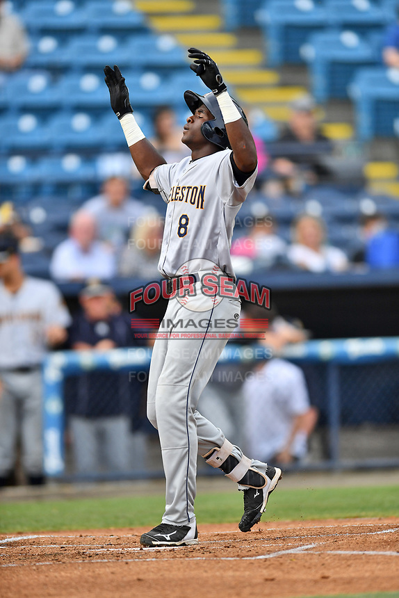 Charleston RiverDogs center fielder Estevan Florial (8) celebrates after hitting a home run during a game against the Asheville Tourists at McCormick Field on July 5, 2017 in Asheville, North Carolina. The RiverDogs defeated the Tourists 10-9. (Tony Farlow/Four Seam Images)