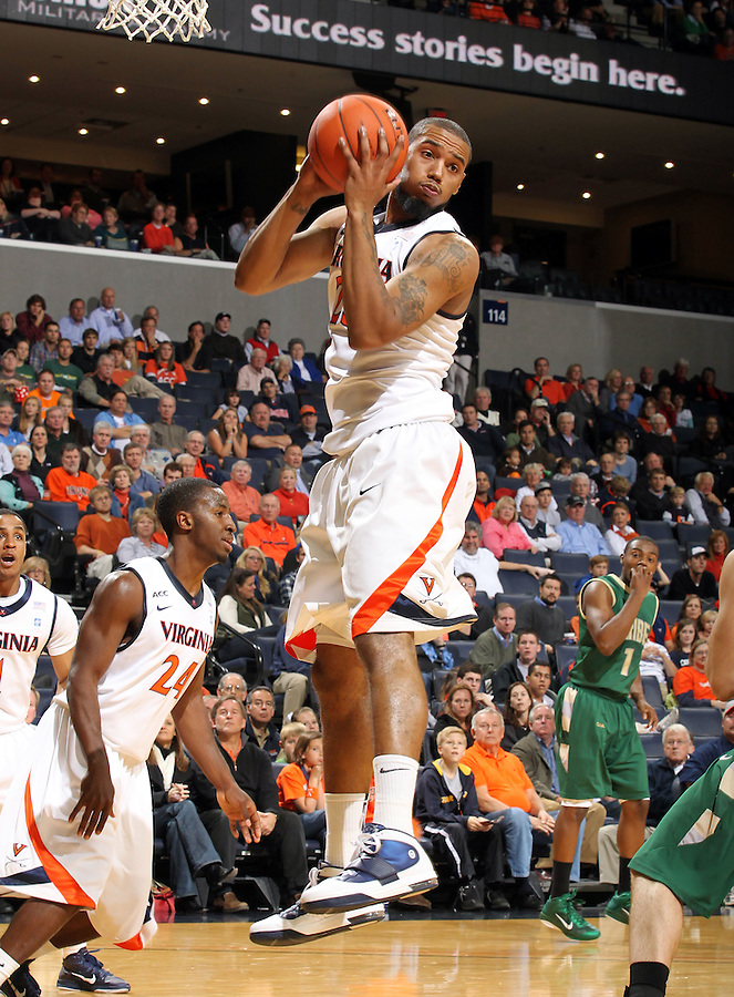 Nov. 12, 2010; Charlottesville, VA, USA;  Virginia Cavaliers forward Mike Scott (23) grabs a rebound during the game against William & Mary at the John Paul Jones Arena.  Mandatory Credit: Andrew Shurtleff-