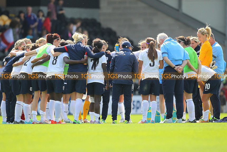 England players huddle at the final whistle - England Women vs Japan Women - Friendly Football International at the Pirelli Stadium, Burton Albion FC - 26/06/13 - MANDATORY CREDIT: Gavin Ellis/TGSPHOTO - Self billing applies where appropriate - 0845 094 6026 - contact@tgsphoto.co.uk - NO UNPAID USE