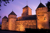 Chateau de Chillon, Switzerland, chateau, Montreux, Lake Geneva, sunset, Vaud, Chateau de Chillon an 13th century fortress illuminated at sunset along the lakeshore of Lac Leman in the Canton of Vaud.
