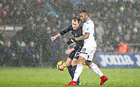 Christian Eriksen of Spurs & Jordan Ayew of Swansea City during the Premier League match between Swansea City and Tottenham Hotspur at the Liberty Stadium, Swansea, Wales on 2 January 2018. Photo by Mark Hawkins / PRiME Media Images.