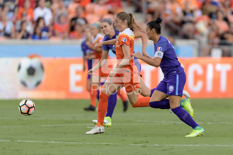 Houston, TX - Saturday June 17, 2017: Janine Beckie races for the goal in front of Ali Krieger during a regular season National Women's Soccer League (NWSL) match between the Houston Dash and the Orlando Pride at BBVA Compass Stadium.
