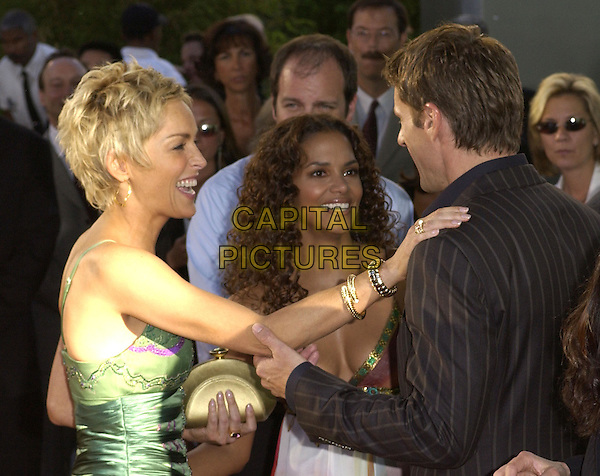 Sharon Stone, Halle Berry and Lambert Wilson .Attends Warner Brothers' World Premiere of Catwoman held at The Arclight Cinerama Dome Theatre in Hollywood, California on July 19,2004..half length.Ref: DVS.www.capitalpictures.com.sales@capitalpictures.com.©Capital Pictures.