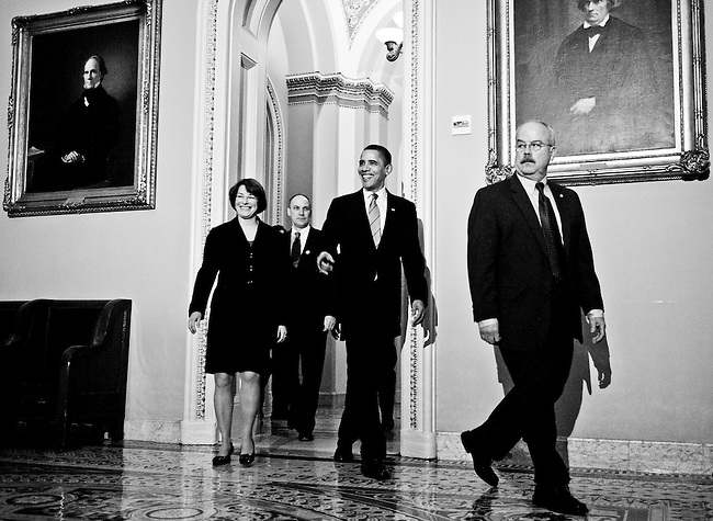 President Barack Obama arrives with Sen. Amy Klobuchar, D-Minn., and Senate Sergeant at Arms Terrance Gainer for a lunch meeting to dicuss the budget  with Senate Democrats in the U.S. Capitol on March 25, 2009.