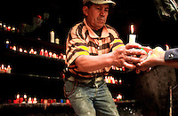 People share candles in Las Lajas Sanctuary (Santuario de Las Lajas) which is a basilica church located in the southern Department of Nariño and built inside the canyon of the Guáitara River. 1/7/2007.   Photo by Joana Toro / VIEWpress.