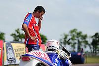 Apr. 29, 2012; Baytown, TX, USA: NHRA pro stock motorcycle rider Hector Arana Jr reacts after losing in the finals during the Spring Nationals at Royal Purple Raceway. Mandatory Credit: Mark J. Rebilas-
