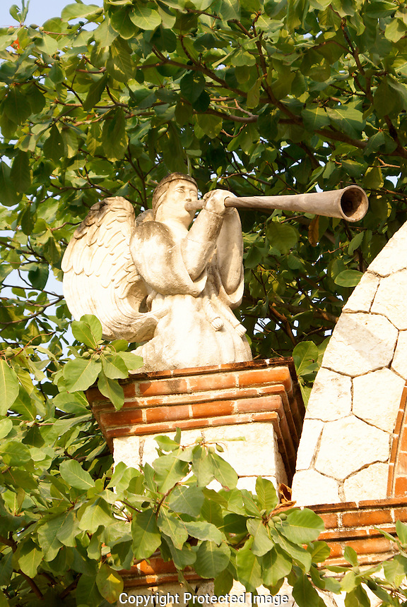 Statue of an angel blowing a trumpet, Xcaret park, Riviera Maya, Quintana Roo, Mexico