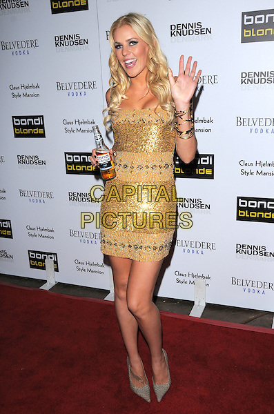 JAIME WRIGHT.The Bondi Blonde Style Mansion held at The Style Mansion International in Beverly Hills, California, USA..February 9th, 2009.full length gold sequins sequined dress hand palm waving grey gray pointy shoes corona beer beverage drink .CAP/DVS.©Debbie VanStory/Capital Pictures.