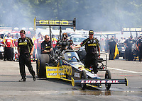Aug. 2, 2014; Kent, WA, USA; Crew members with NHRA top fuel dragster driver Richie Crampton during qualifying for the Northwest Nationals at Pacific Raceways. Mandatory Credit: Mark J. Rebilas-