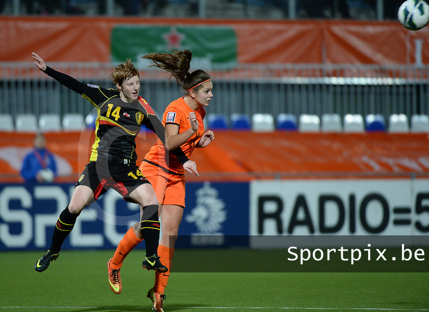 20140212 - ZWOLLE , THE NETHERLANDS : header pictured with Belgian Lien Mermans (l) and Dutch Lieke Martens (r) during the female soccer match between The Netherlands and Belgium , on the fifth matchday in group 5 of the UEFA qualifying round to the FIFA Women World Cup in Canada 2015 at Het Ijseldelta Stadion , Zwolle . Wednesday 12th February 2014 . PHOTO DAVID CATRY