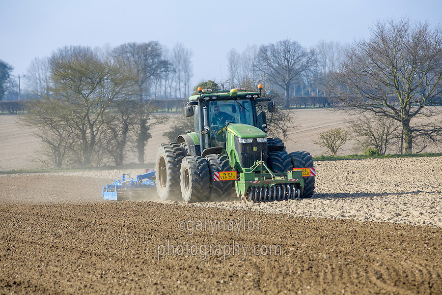 John Deere 7230R with Lemken Kompaktor preparing sugar beet seed bed - Norfolk, March