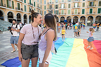 PALMA DE MALLORCA, SPAIN – JUNE 28: Protesters kiss  each other as they claims the rights of the LGTB+ community respecting the safety distances as a result of the COVID-19 crisis on June 28, 2020 in Palma de Majorca, Spain. LGBT+ community from Balearic Islands are celebrating the 51st anniversary of the Stonewall Riots. (Photo by Joan Amengual / VIEWpress via Getty Images).
