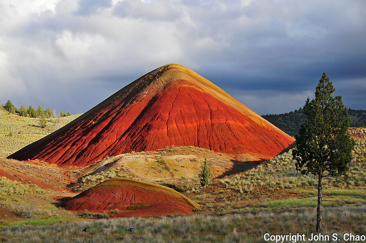 The Red Hill lit by sunlight at Painted Hills National Monument, Oregon.